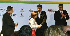 Martha Luz Amorocho, who lost her son in a terrorist attack, hugs a demobilized FARC member.
